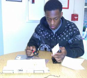 Team B3AST member makes repairs